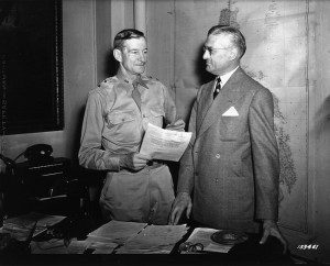 Maj. Gen. Alexander D. Surles (left) confers with National League president Ford Fick in May 1942.