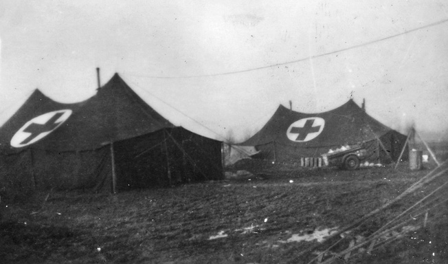 The abandoned and wrecked American field hospital discovered by troops of B Company. This eerie photo is another taken by Private First Class Carmen Gisi with the camera he found lying in a nearby foxhole. The medical personnel and patients at the hospital were either killed or captured by the Germans.