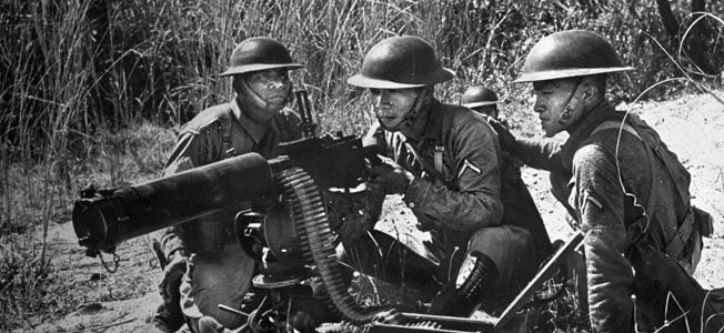 Before Japan's invasion, Filipino troops train with a .30-caliber water-cooled machine gun. Inadequately trained, the Filipinos fought bravely but eventually were overrun by the Japanese.