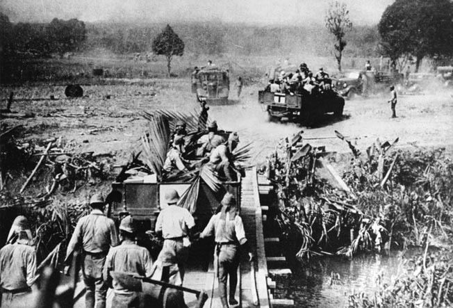Philippines from Japanese control began in the autumn of 1944. OPPOSITE: In this April 3, 1942, photo, Japanese soldiers move forward on foot and aboard vehicles during their victorious onslaught in the Philippines. The Japanese occupation of the Philippines was completed with the surrender of American and Filipino troops on the Bataan Peninsula and the island of Corregidor.
