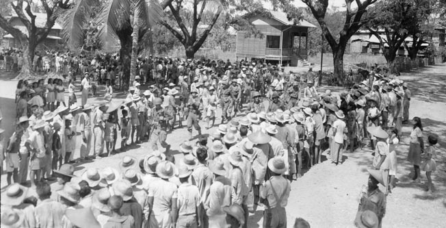 During the liberation of the Philippines on January 29, 1945, American troops are welcomed by the townspeople in the village of San Marcelino on the Bataan Peninsula. The land campaign to wrest the Philippines from Japanese control began in the autumn of 1944.