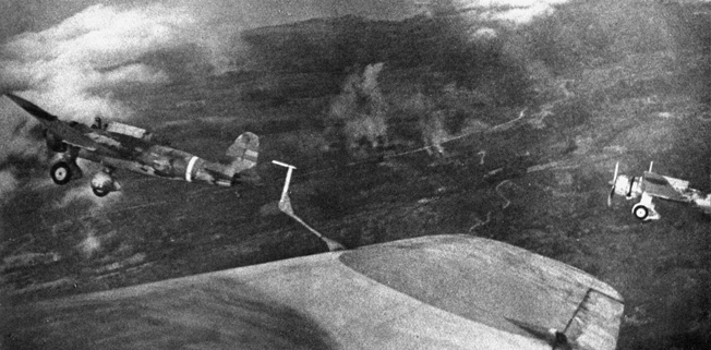 A flight of Mitsubishi Ki-30 light bombers, codenamed Ann by the Allies, execute bombing runs against American and Filipino positions on the Bataan Peninsula.