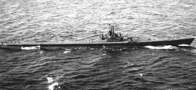 On patrol in the open sea, the submarine USS Batfish is photographed from the air on September 20, 1943.