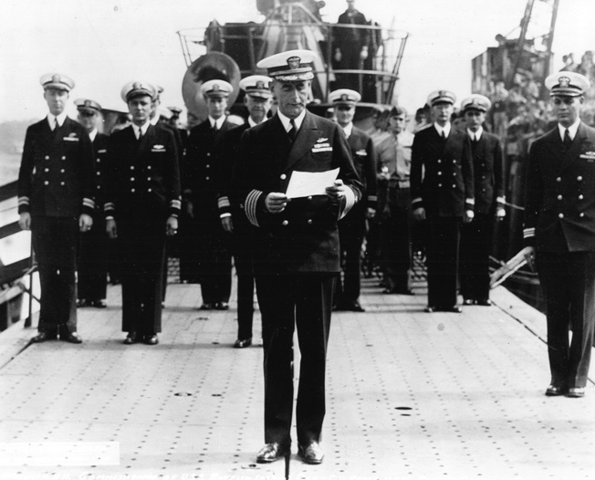 An officer reads orders during the commisioning of the new submarine USS Batfish at the Portsmouth Navy Yard on August 21, 1943.