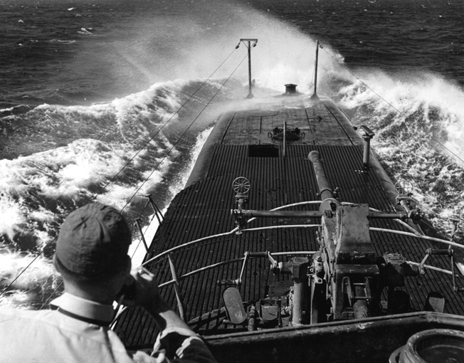 Standing in the conning tower of the USS batfish, a U.S. Navy officer scans the horizon for Japanese ships during a combat patrol on May 5, 1945.