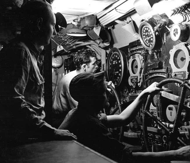 The diving officer and two enlisted men prepare to send the USS Batfish into a dive on May 1, 1945.