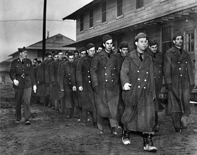 The Bedford Boys arrived at Fort Meade, Maryland, in February 1940 and underwent arduous training. These soldiers are participating in close-order drill in preparation for deployment to Europe.
