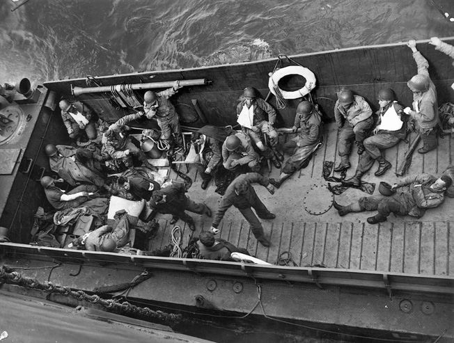 A few of the wounded soldiers evacuated from the Normandy beaches head back to the safety of Britain aboard a U.S. Coast Guard vessel. Medics braved murderous German fire to render aid to the wounded on Omaha Beach and often presented easy targets for German gunners despite their helmets emblazoned with red crosses.