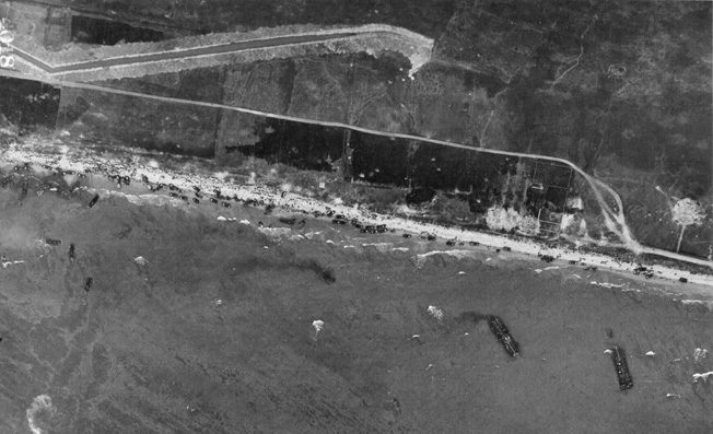 This aerial image of Omaha Beach on D-Day shows troops of the U.S. 1st and 29th Infantry Divisions struggling to reach cover and eventually advance against German fortifications. The situation on Omaha Beach remained in doubt for some time, and General Omar Bradley, commander of American invasion forces, considered evacuating the troops.