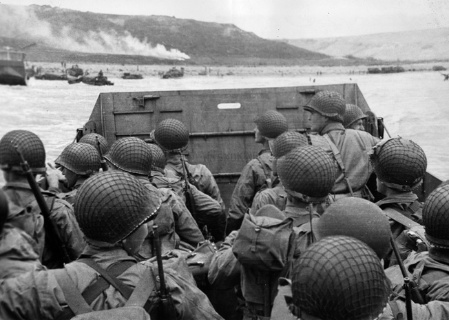 As their landing craft bobs and weaves its way toward Omaha Beach, American soldiers observe the chaotic maelstrom of combat into which they are about to plunge.