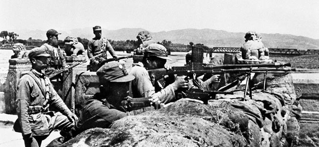 At the height of the tension between the Japanese Kwantung Army and the Chinese forces stationed in the vicinity of the Marco Polo Bridge, Chinese troops of the 29th Army man hastily constructed defensive positions on July 8, 1937.