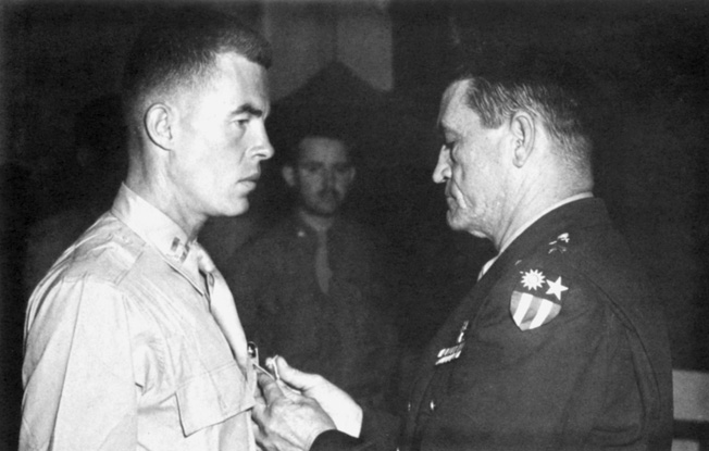 Recognizing Lt. John Birch for his bravery in undertaking hazardous missions behind Japanese lines in China, General Claire Chennault, commander of the U.S. Fourteenth Air Force, pins a medal on the hero's chest.