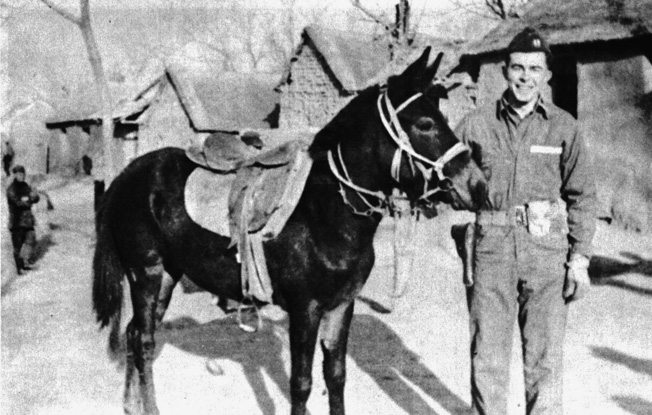 John Birch poses with a Mongolian pony he once rode for 60 miles through a snowstorm over rough terrain in one day.