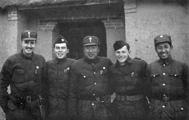 Lt. John Birch (second from left) and a pair of fellow Americans pose with officers of the Chinese Army.