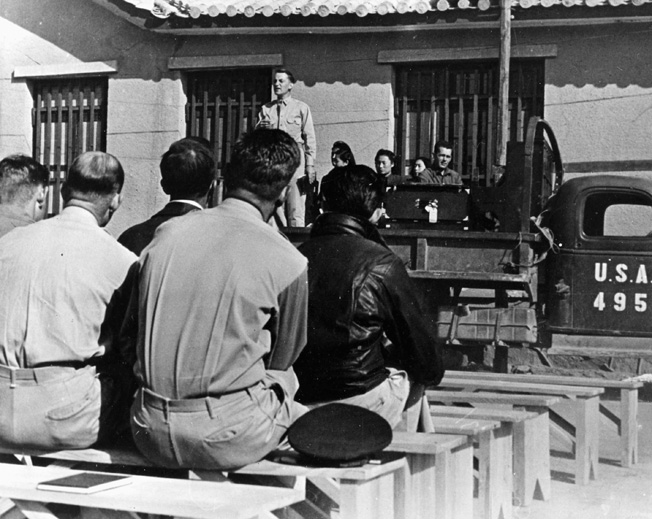 Men of the U.S> Fourteenth Air Force attend Sunday church services at their base in China.
