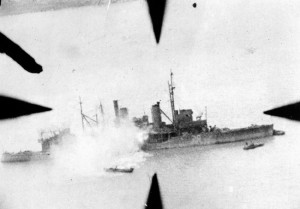 A bomb hit on a Japanese patrol boat is recorded by a photographer aboard an American aircraft. During the same mission in which they sank this vessel off the Shantung Peninsula, pilots of the U.S. Fourteenth Air Force destroyed 45 Japanese planes on the ground and damaged 55 others.