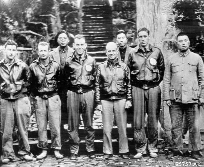 Lt. Col. and future Gen. Jimmy Doolittle poses with several of his fellow survivors of the famed April 1942 raid on Tokyo. Also pictured is one of the friendly Chinese who risked their lives to shelter the raiders from the vengeful Japanese.