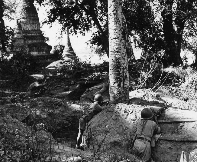 Keeping a sharp lookout for movement by the Japanese enemy, Chinese soldiers have taken cover in deep and lengthy trenches just beyond the Burmese frontier.