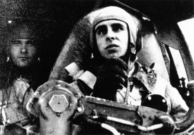 Luftwaffe pilot Karl-Heinz Thurz at the controls of a Heinkel He-111 bomber during one of many air raids on Britain during the war.