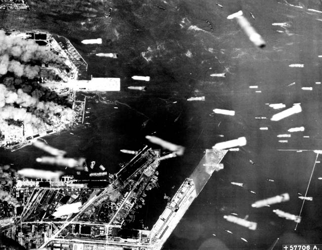 Incendiary bombs rain down on the waterfront installations of Osaka, 240 miles southwest of Tokyo, in June 1945. A series of raids in March, June, July, and August 1945 caused 10,000 deaths at Osaka.