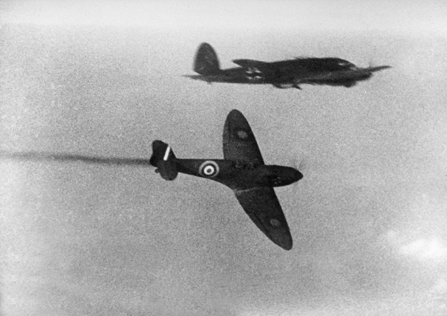 With its distinctive butterfly wings prominent in this photo, a British Supermarine Spitfire fighter attacks a German Heinkel He-111 bomber during the Battle of Britain. The Spitfire was the most advanced fighter in the British arsenal at the time, and many pilots flew the capable Hawker Hurricane.