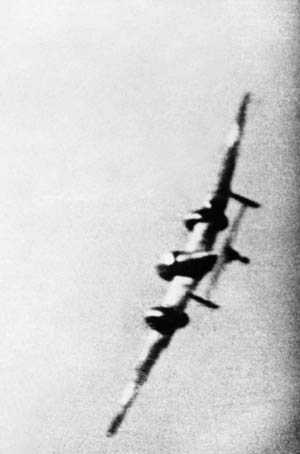 Gun camera footage from the Spitfire flown by Pilot Officer M.E. Staples shows a German Messerschmitt Me-110 fighter frantically banking to port to elude the British pilot's machine-gun fire. Staples, a pilot of No. 609 Squadron, was one of those who proved the superiority of the Spitfire against most German bombers and twin-engine fighters dur- ing the Battle of Britain.
