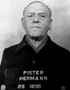 An expressionless Herman Pister, the second and final commandant at Buchenwald, was photographed by American military police following his capture.
