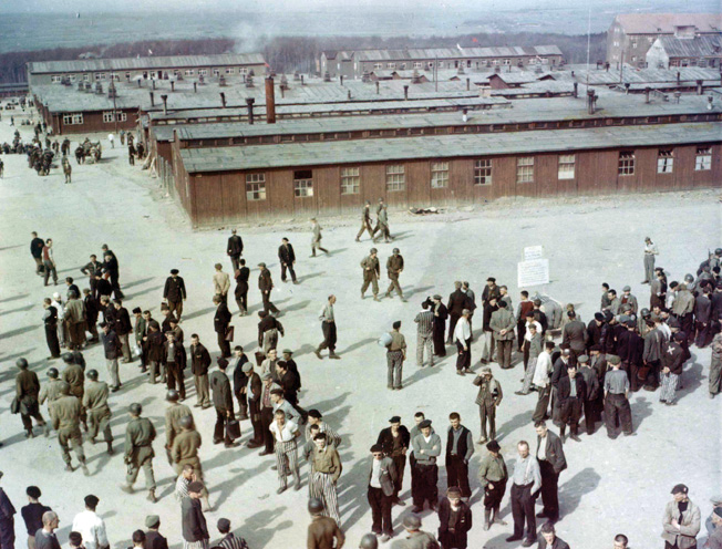 Waiting for transportation to Displaced Person Camps, former prisoners of Buchenwald who are able to walk mill around in the compound. Ultimately, they would be repatriated. This photo was taken from the guard tower near the main gate, which dominated the entire camp.