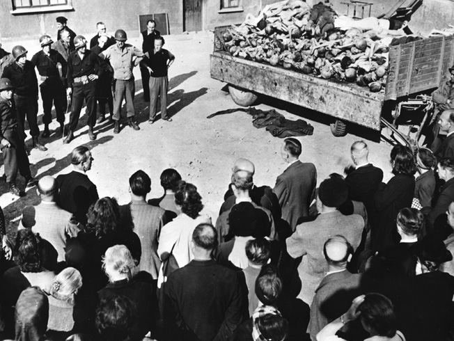 German civilians are forced to view the stacked bodies of dead Buchenwald inmates following the liberation of the camp. Some of the residents of nearby towns asserted that they were completely unaware of the atrocities taking place so close to their homes.