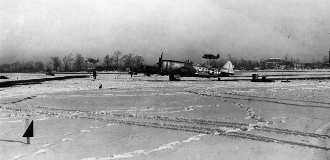 Rugged Republic P-47 Thunderbolt fighter bombers of the 365th Group take off on a tactical support mission during the Battle of the Bulge.