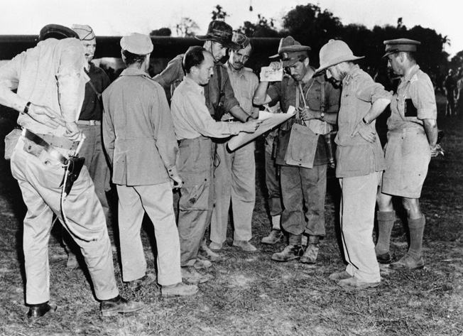 Brig. Gen. Orde Wingate, commander of the c hindits in Burma (far right) briefs staff officers before take-off near the main base at Sylhet, Assam. To Wingate's immediate right is Mike Calvert.