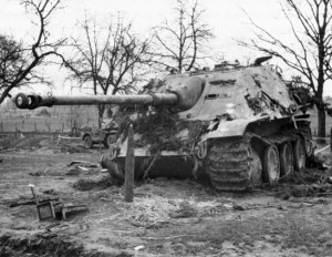 A destroyed German 88mm self-propelled assault vehicle lies silent in the wake of Operation Blockbuster. The casualties on both sides were severe, with the Queen's Own Rifles sustaining many dead and wounded.
