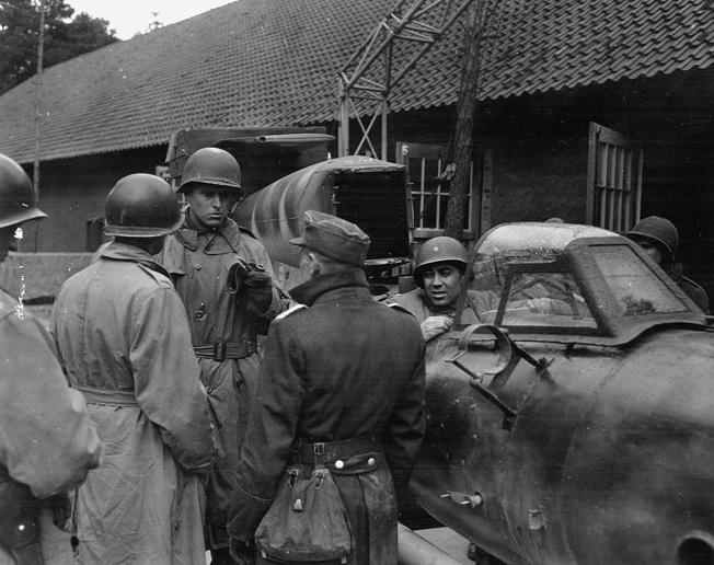 Soldiers of the 5th Armored Division examine a German V-1 suicide bomb.