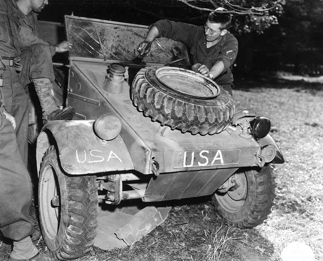 A soldier repaints a captured German vehicle which will then be used by the U.S. Army's 28th Division in Saint Manvieu, France.