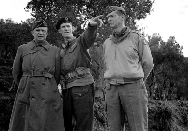 Lieutenant General Sir Richard McCreery (center), commander of the British X Corps, gestures during conversation with General Dwight D. Eisenhower (left), supreme Allied commander in the Mediterranean Theater, General Mark Clark (right), commander of the Allied Fifth Army, during a meeting at San Martino on December 23, 1943.