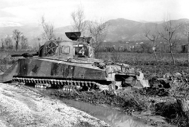 In an effort to slow Allied progress, the Germans often opened dams and flooded low-lying areas. Here, an Allied tank has become bogged down in the soggy ground near the Rapido River on February 8, 1944.