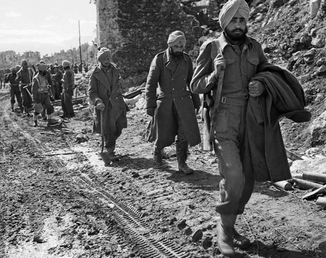 Brigade, 4th Indian Division move through the ruins of Cassino. During the four-month-long battle, the Allies had eight different nationalities represented in their ranks.