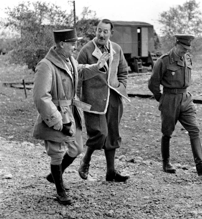 General Alphonse Juin (left) chats with General  Sir Harold Alexander, commander of Allied  troops in the Mediterranean Theater, during the exhaustive attempts to crack the stubborn defenses of the Gustav Line in the spring of 1944.