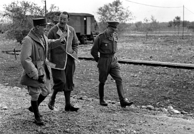 Pictured left to right at Eighth Army tactical headquarters in March 1944, General Sir Harold Alexander, commander of Allied forces in Italy; General Sir Oliver Leese, commander of the British Eighth Army; and General Alphonse Juin, commander of the French Expeditionary Corps, discuss plans for a coming attack.