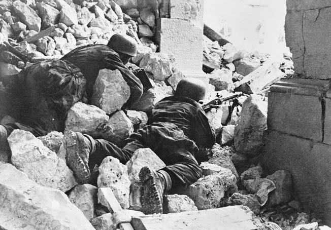 German paratroopers man a machine-gun position amid the ruins of the abbey of Monte Cassino.