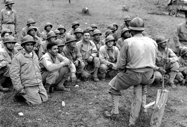 Gouniers, fierce fighters of the 2nd French Moroccan Division, receive a final briefing on German troop dispositions prior to relieving the U.S. 34th Infantry Division on the front line near Cassino in December 1943. The rugged Gourniers were already renowned for their combat skills in mountainous terrain prior to their arrival in Italy.