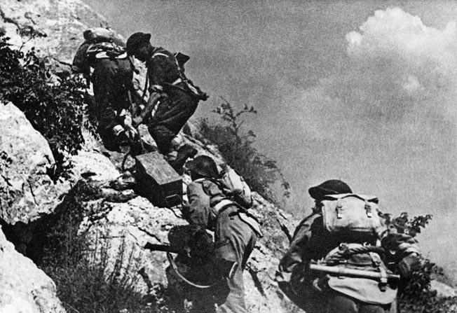 Polish soldiers of the 3rd Carpathian Division haul ammunition up the steep, rocky terrain of Monastery Hill in May 1944. After other divisions had tried and failed, Lt. Gen. Wladyslaw Anders' Poles finally claimed the abbey after the Germans withdrew from the heights.