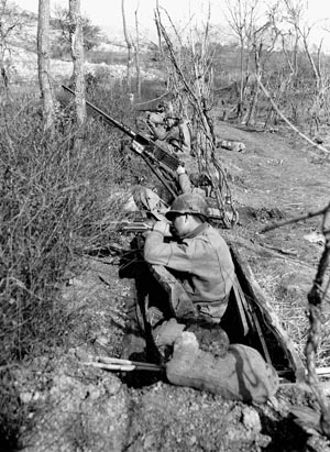 Men of the U.S. 36th Division form a firing line in a shallow ditch during the disastrous attempt to cross the Rapido River and outflank the Cassino defenses.
