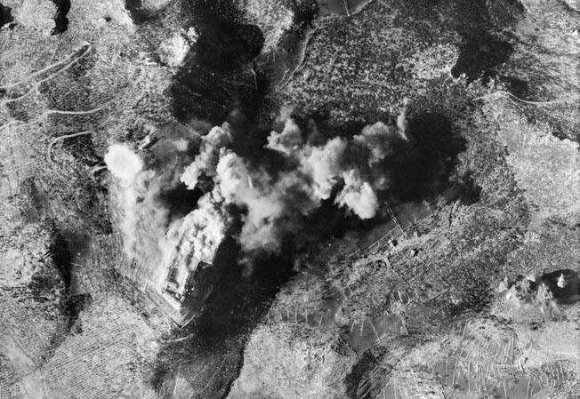 Clouds of dust and smoke obscure this aerial view above Monastery Hill, where St. Benedict established the monastery in ad 529. The New Zealand commander had demanded that the abbey be destroyed before he would send his men to attack the hill.