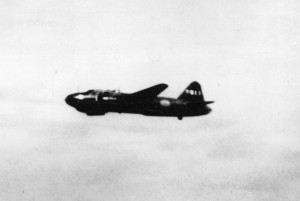 "A Japanese Mitsubishi ""Betty"" bomber is photographed from the Chicago on July 7, 1942. The versatile Betty could carry torpedoes or bombs."