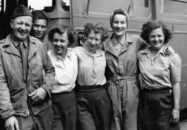 Jill, second from right, poses in front of her clubmobile. More than 7,000 young women volunteered for service with the Red Cross during World War II.