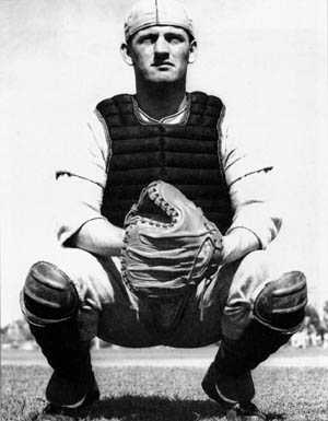 "Airborne veteran Lynn ""Buck"" Compton is shown in his catcher's gear while playing baseball for UCLA. Compton proved himself a fine athlete and later played minor league baseball."