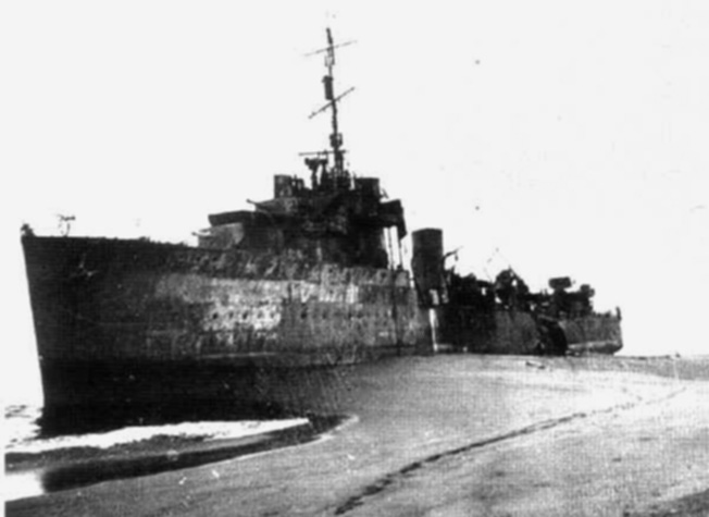 The elderly World War I-vintage destroyer HMAS Voyager lies forlornly aground at Betano Bay on the island of Timor. The ship was later ravaged by Japanese bombers.