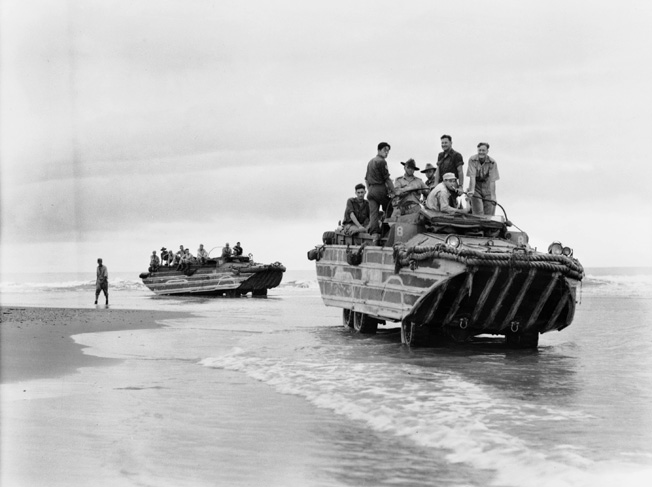 On July 11, 1944, soldiers of 2/10 Commando Squadron are shown hitching rides aboard American-built amphibious DUKW craft as they deploy to Babiang, New Guinea.