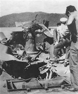 Heavy bomb damage inflicted during a Japanese air raid on September 4, 1943, is evident aboard the LST 473, which carried Australian commandos to the shore of New Guinea at Lae.
